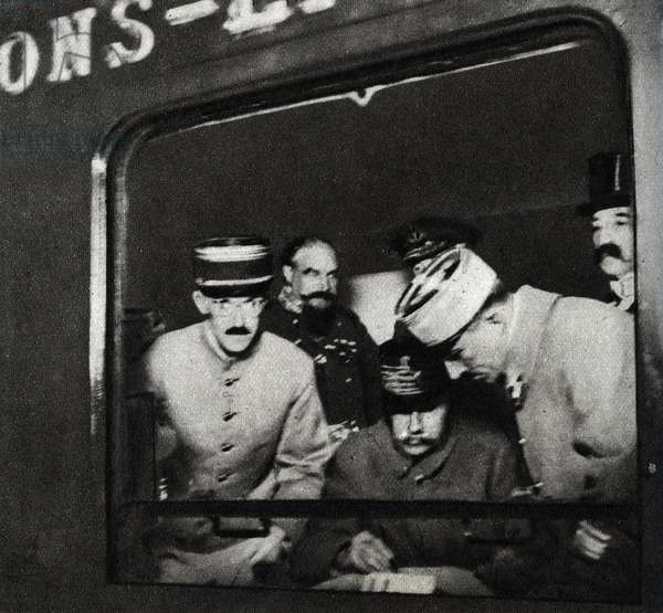 """Signing of the armistice in the railway carriage at Compiegne, November 11, 1918, - First World War (1914-1918): Marechal Ferdinand Foch (1851-1929) during the signing of the Armistice in a wagon of the General Staff Train calls the """"Armistice wagon"""" in the Rethondes clearway, in the forest of Compiegne on 11/11/1918"""