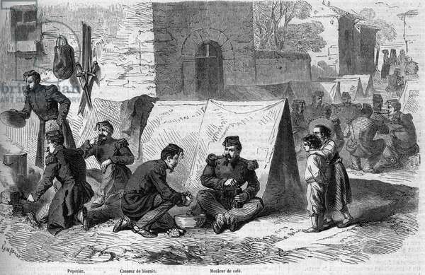 """Preparation of the """""""" popote"""""""" (meal) of the 1st regiment of grenadiers of the French Imperiale Guard during the Risorgimento. From left to right: a """"popotter"""", a """"biscuit breaker"""" and a """"coffee maker"""". Cavriana, Italy, 1859. Engraving in """""""" Le Monde Illustré"""""""" n°121 of 6 August 1859."""