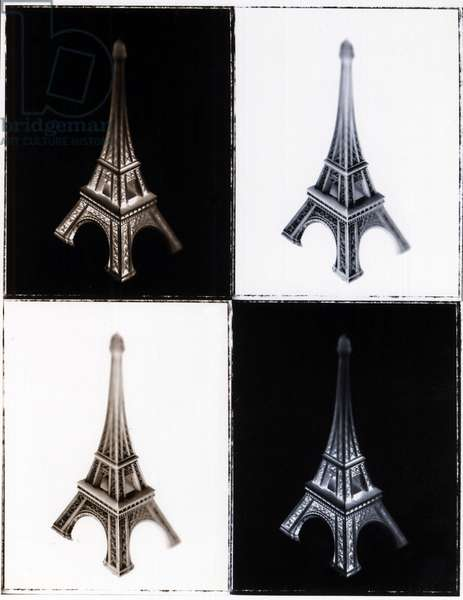 Symbol of Paris and France: Still life with miniature Eiffel Tower. Positive and negative Black and White photography