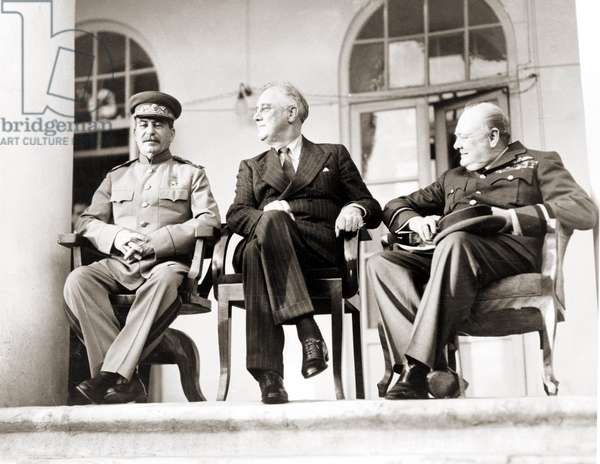 Teheran Conference (28 November-1 December 1943). Stalin (1879-1953), Roosevelt and Churchill - Conference by Teheran - Sovietic leader Stalin (L), US President Roosevelt (C) and British Prime Minister Winston Churchill during the Tehran conference, the first inter-allied conference of World War Two Conference by Teheran 28 November 1943 -. Stalin (1879-1953), Roosevelt and Churchill.