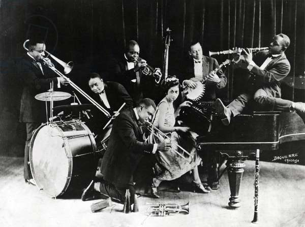 Trumpeter Louis Armstrong with King Oliver's Creole Jazz Band in Chicago in 1923 with Baby Dodds, Honore Dutry, King Oliver, Bill Johnson, Johny Dodds (clarinet) and Lil Hardin Armstrong (Lillian Harding Armstrong, wife of Louis Armstrong)