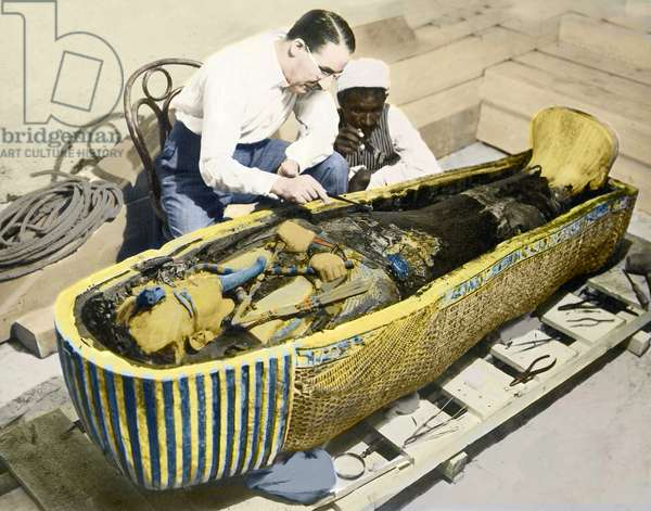 Egypt-1922 : English archaeologist Howard Carter (1873-1939) and an Egyptian assistant examining the sarcophagus of King Tutankhamen.