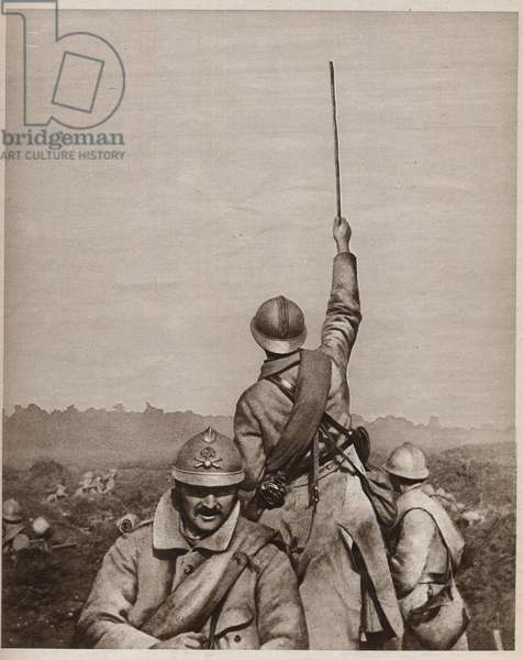 "First World War (1914-1918): An exit of the trench in the Somme - the officer raised his cane, symbol of authority, to deter the attack on enemy positions. Photographie In """" Le Miroir"""", 20 August 1916 - WWI: a sortie from the trenches in the Somme (Battle of the Somme), Photography from """" Le Miroir"""", 20th August 1916"