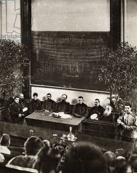 """Russian Revolution of 1917: opening session of the Universite of Republican Soldiers"""" in Petrograd. The purpose of this association is to educate seafarers. Members of the Soviet and Chairman of the Council of the Provisional Government Alexander Kerensky (or Kerenski) preside over the session"""" In """""""" The mirror"""""""" 1917"""