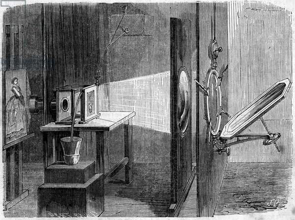 """Light Door Applies to Photography invented by Edouard Delessert (1828-1898). The mirror reflects the sun's rays and returns them to a lens that reunites them in a beam to make them converge on a cliche whose image, reproduced by a Daguerre camera, is fixed in the desired size on a prepared paper. Engraving in """""""" Le Monde Illustrée"""""""" n°232 of September 21, 1861."""