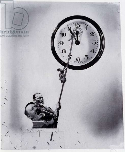 Reproduction of a photogaphic photomontage by Helmut Herzfeld known as John Heartfield (1891-1968) of 1942 staging Adolf Hitler and Hermann Goering holding the hands of a clock. (propaganda, anti-Nazism) Private collection