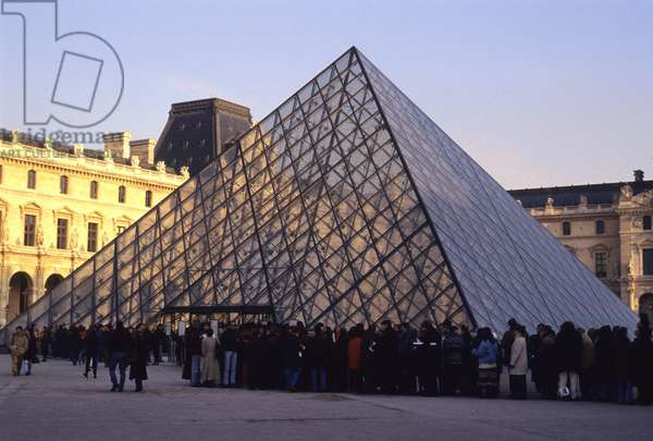 The queue in front of the pyramid of Louvre in Paris. Architect of the pyramid: Ieoh Ming Pei.