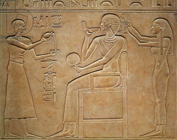 Queen Kawit at her toilet, from the sarcophagus of Queen Kawit, found at Deir el-Bahri, Middle Kingdom, c.2061-2010 BC (stone relief)