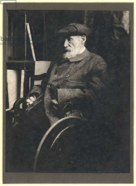 Auguste Renoir (1841-1919) in a wheelchair (b/w photo)
