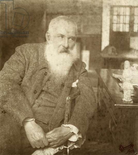 Claude Monet (1841-1926) with a Tanagra statuette, early 20th century (gelatin silver print) (b/w photo)