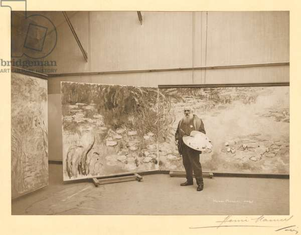 Claude Monet (1840-1926) in front of his paintings 'The Waterlilies', in his studio at Giverny, 1920 (gelatin silver print) (b/w photo)