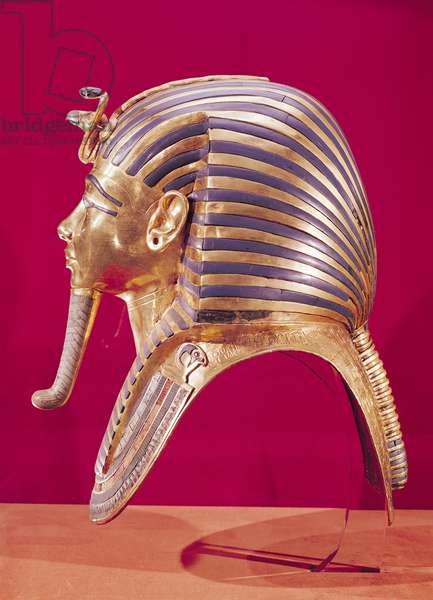The gold mask, from the Treasure of Tutankhamun (c.1370-52 BC) c.1340 BC (gold inlaid with semi-precious stones) (see 179987 for opposite side)