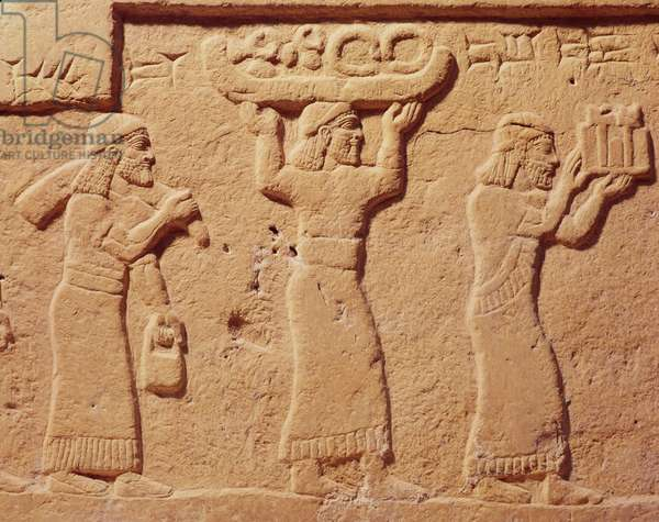 Relief depicting porters laden with gifts (stone)