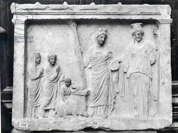 Man, woman and child before an altar offering a sow as a sacrifice to Demeter and Kore (stone) (b/w photo)