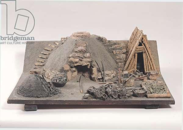 Model of a Gaulish forge of c.750 BC (mixed media)