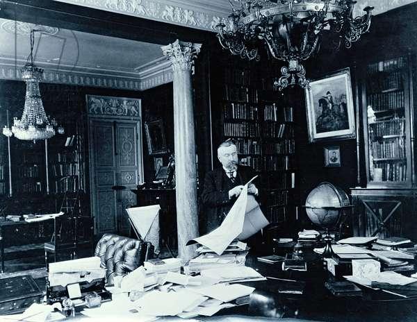 Portrait of Paul Marmottan (1856-1932) in his study, 1911 (b/w photo)