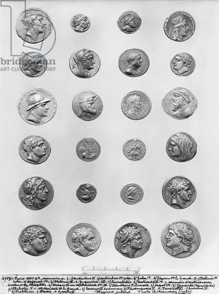 Twenty four coins (metal) (b/w photo)