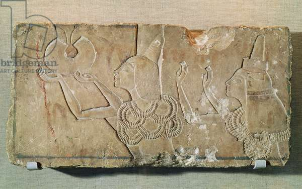 Stele depicting Ay (1352-48 BC) and his wife Teye, receiving the gold of recompense, as a token of the esteem of Akhenaten, from the tomb chapel of Ay at Tell el-Amarna, New Kingdom (limestone carved in low relief)