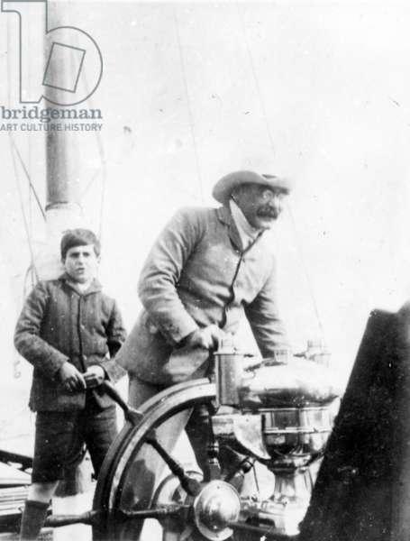 Rudyard Kipling and his son John on the yacht 'Bantam', c.1910 (b/w photo)