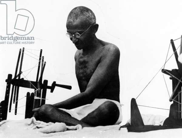 Gandhi at a Spinning Wheel, 1925 (b/w photo)
