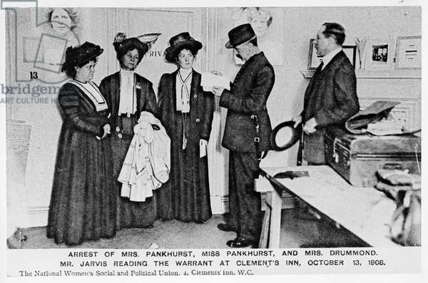 Arrest of Mrs Pankhurst, Miss Pankhurst and Mrs Drummond. Mr.Jarvis reading the warrant at Clements Inn, October 13, 1908 (b/w photo)