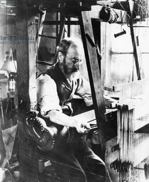 Man working at a handloom (b/w photo)
