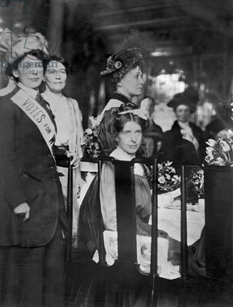 Christabel, Emmeline and Sylvia Pankhurst with Mrs Pethick Lawrence (behind) at WSPU reception, 1909-12 (b/w photo)
