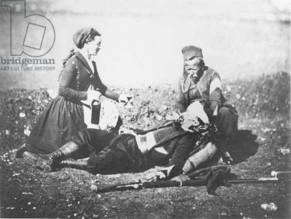 A Nurse Tending a Wounded Man in the Crimea, c.1855 (b&w photo)