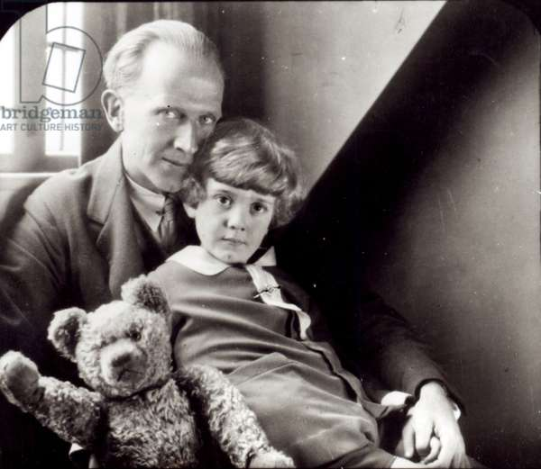 A. A. Milne (1882-1956) and his son Christopher Robin (b.1920) with Winnie-the-Pooh, 1926 (b/w photo)