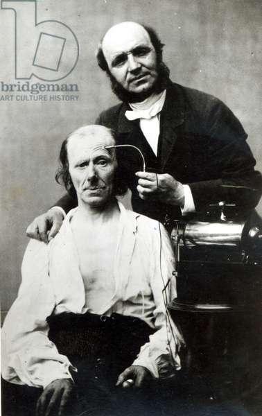 Duchenne de Boulogne with a 'victim patient', 1862 (b/w photo)