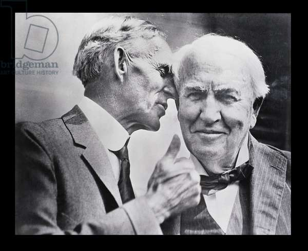 Henry Ford (1863-1947) talking to his close friend Thomas A. Edison (1847-1931) (photo)