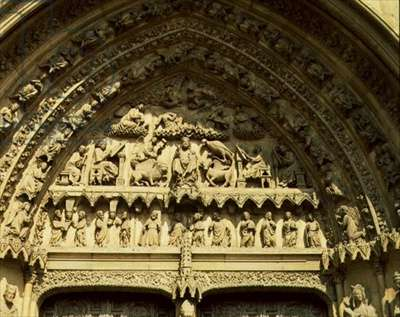 Tympanum of the south transept portal depicting the Apocalyptic Christ and the Evangelists, 13th century (photo)