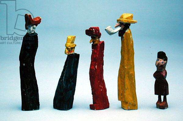 Carved figures from the series 'The Town at the End of the World' (painted wood)