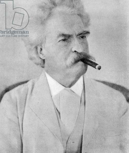 Mark Twain in white suit with cigar