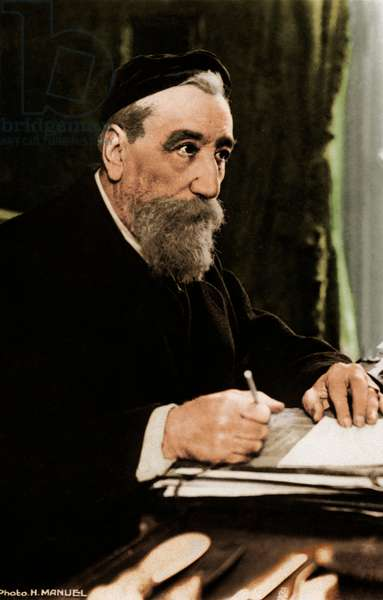 Anatole France at writing desk