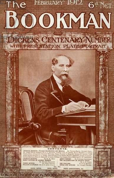 Charles Dickens writing at