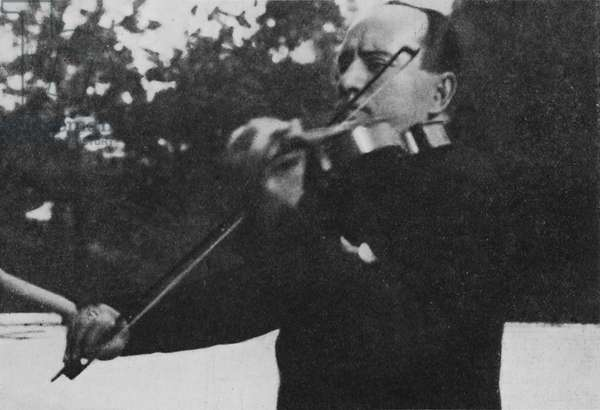 Benito Mussolini playing the
