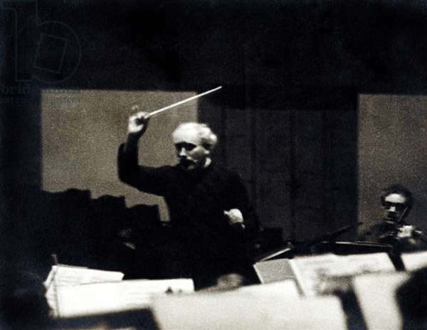 Arturo Toscanini conducting with