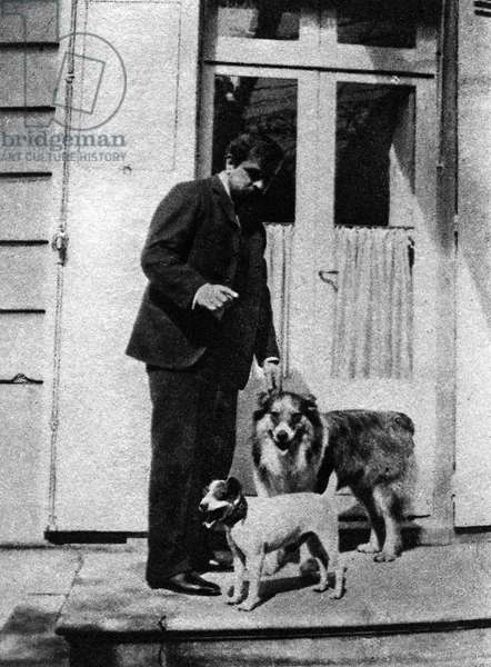 Claude Debussy with his dogs 'Boy' and 'Xanto'