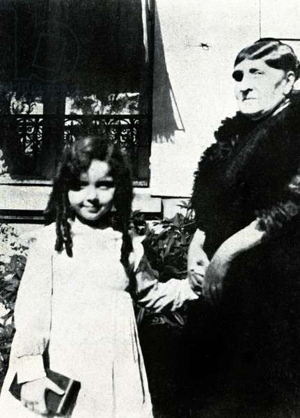 Claude- Emma (Chouchou) Debussy (child) with unknown woman