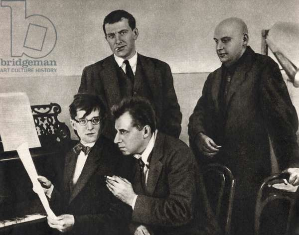 Dmitri Shostakovich at the piano with Mayakovsky, Meyerhold and Rodchenko in Moscow, 1929