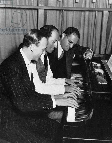 Fred Astaire. George and Ira Gershwin in rehearsal for 'Shall We Dance'.