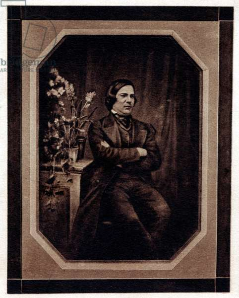 Robert Schumann seated with