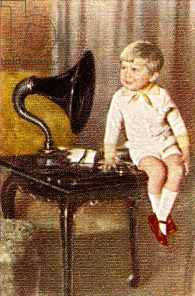 Boy listening to gramophone