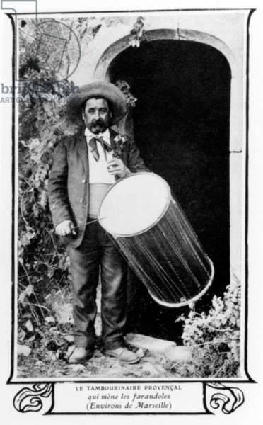 Man playing provencal drum