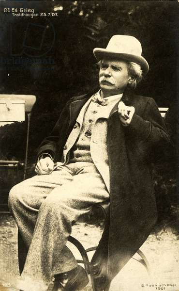 Edvard GRIEG seated wearing