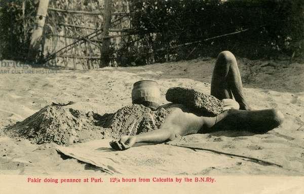 Man undergoing penance at Puri, India