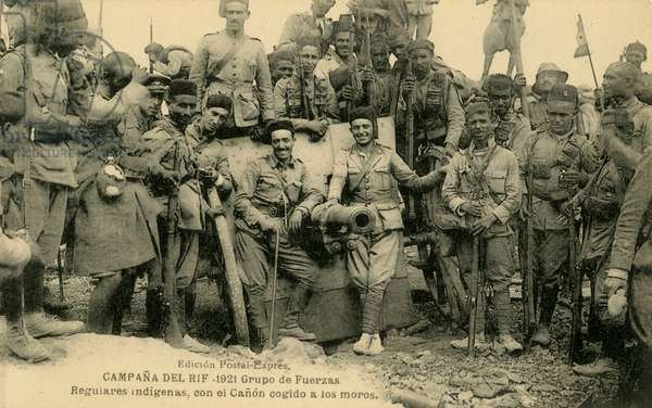 Spanish Regulares around a captured Berber canon