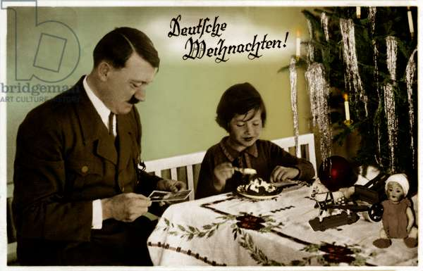 Adolf Hitler with a child