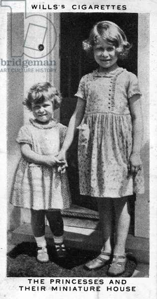 Princess Elizabeth and Princess Margaret with their miniature house,